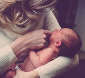 infant baby with mother